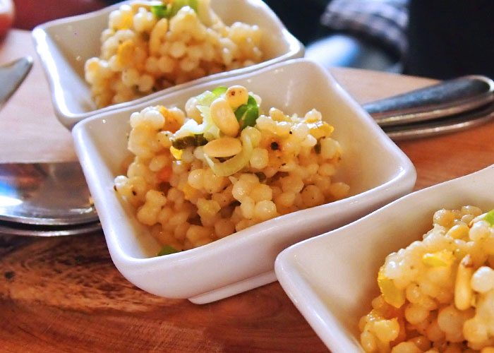 Close up of couscous in small servings.