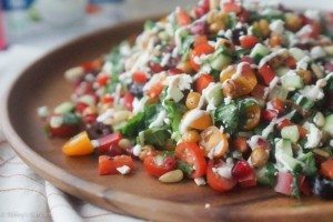 Healthy Crispy Chickpea Greek Salad with Pomegranates & Tzatziki Drizzle