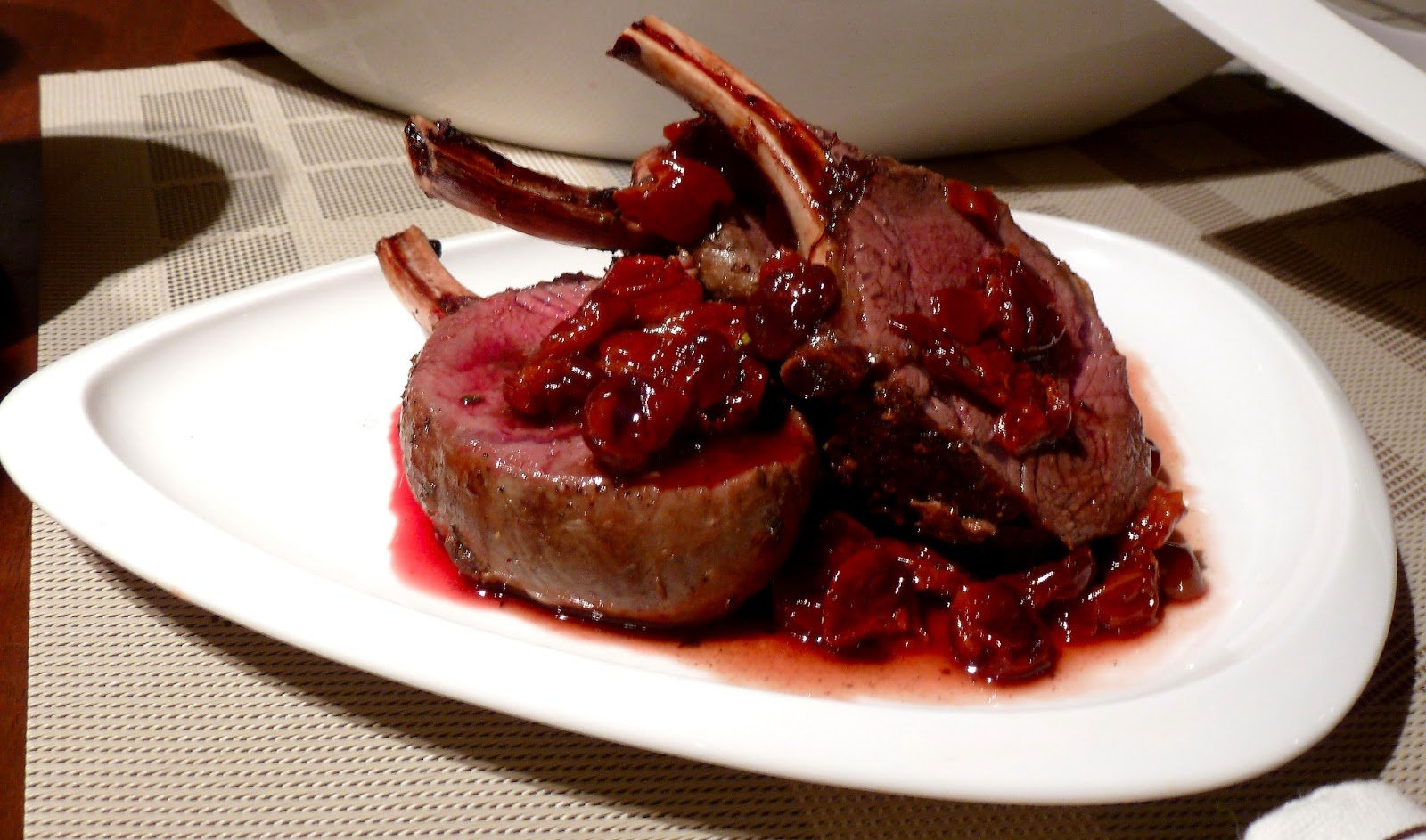 rack of venison on a white dish